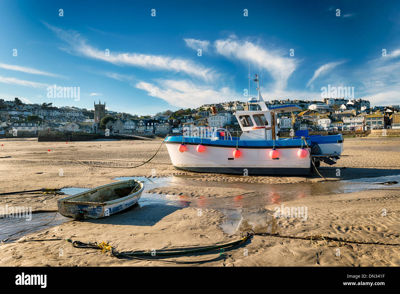 Fishing boats on the sea front at St Ives in Cornwall Stock Photo