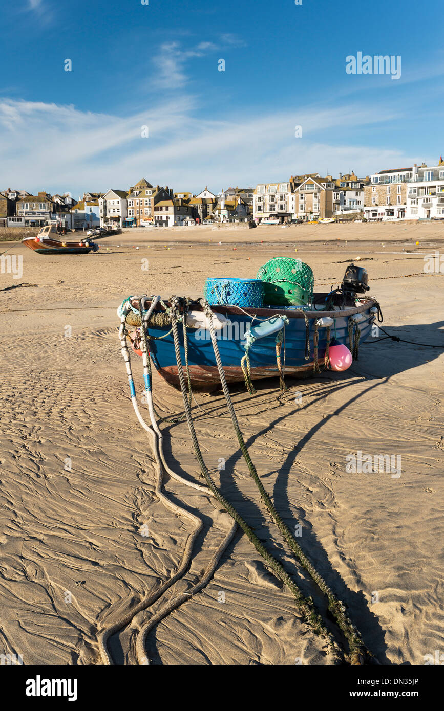 Fishing boat on the beach at St Ives in Cornwall - Stock Image
