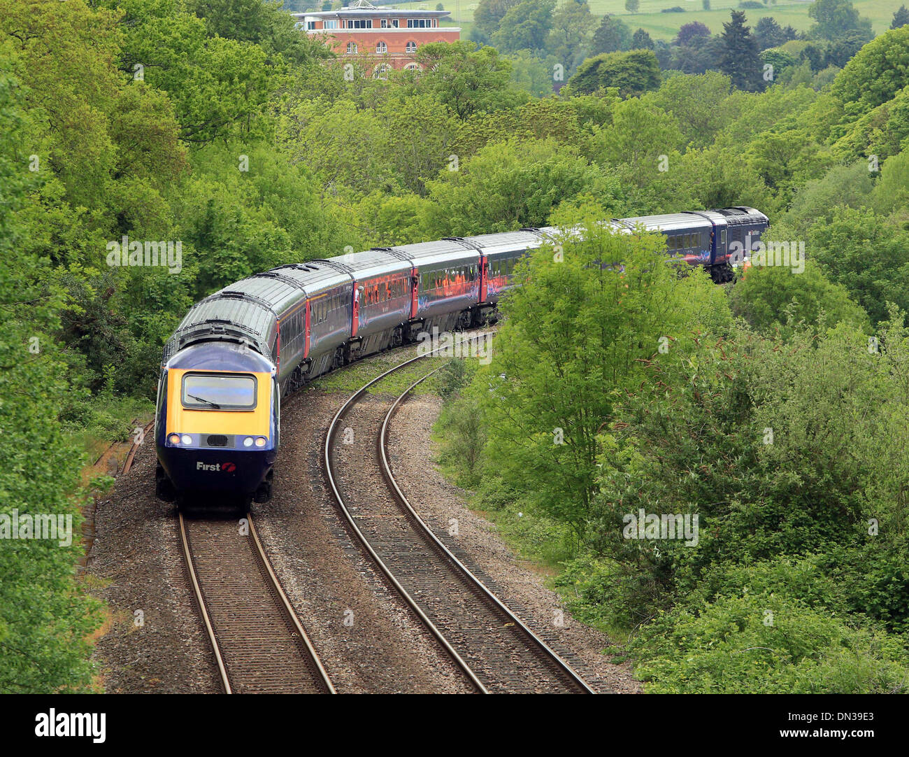 Train on a viaduct on the outskirts of Stroud, Gloucestershire - Stock Image