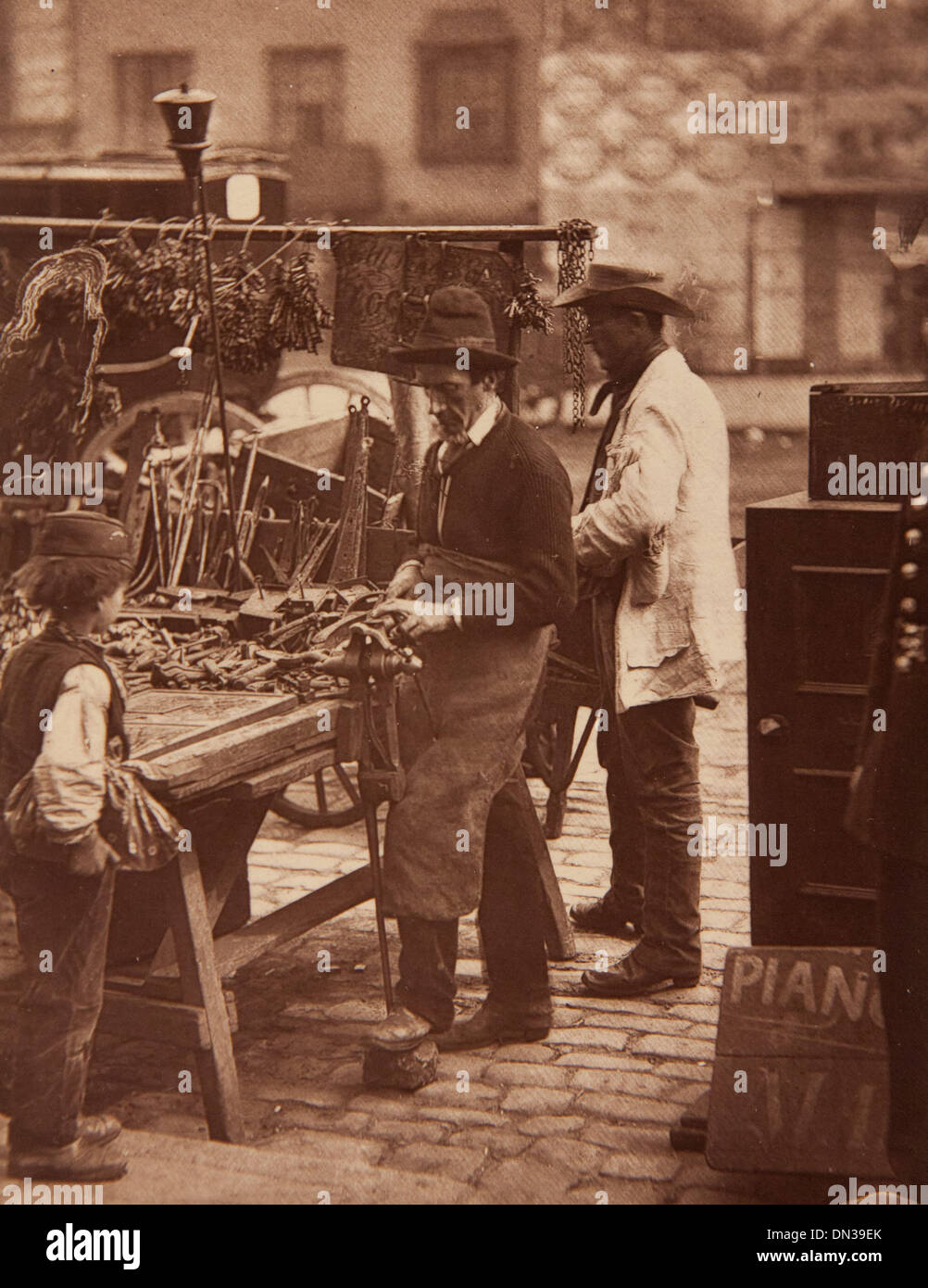 Photograph showing 'The street locksmith' in the Street Life in London book - Stock Image