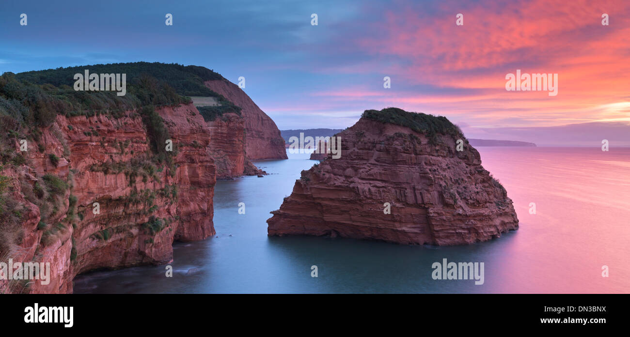 Dawn skies above Ladram Bay, Devon, England. Autumn (September) 2013. - Stock Image