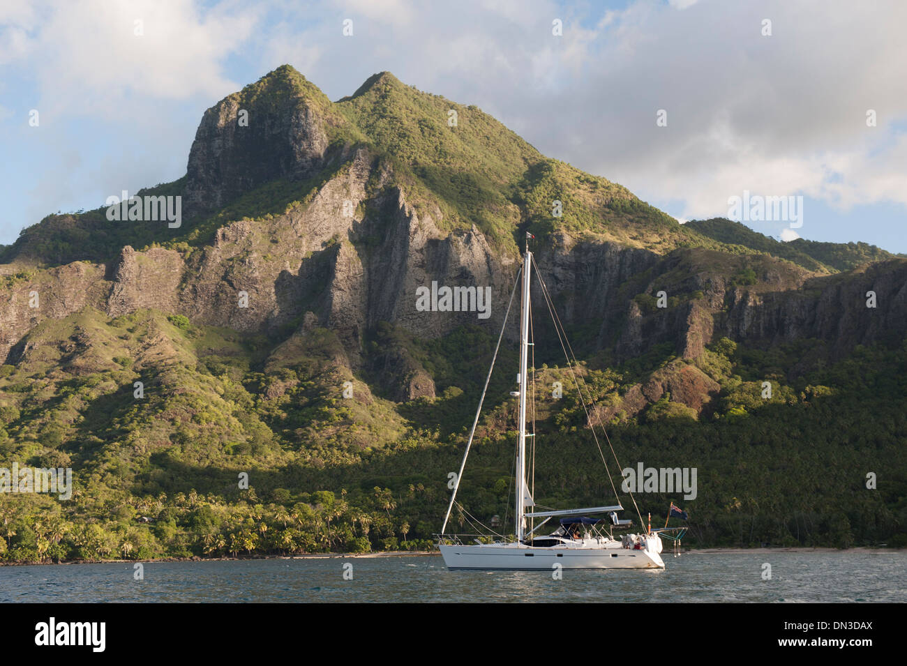 A blue water cruising yacht at anchor in Baie d'Anaho (Anaho Bay), north east Nuku Hiva, Marquesasa, French Polynesia - Stock Image
