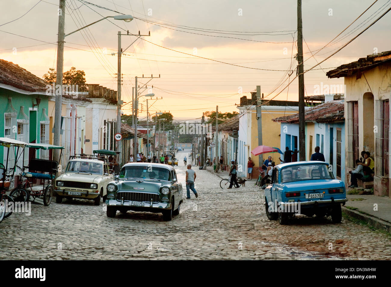 Trinidad, Cuba -  a sunset street scene with old American car on the street,  Trinidad, Cuba, Caribbean, Latin America - Stock Image