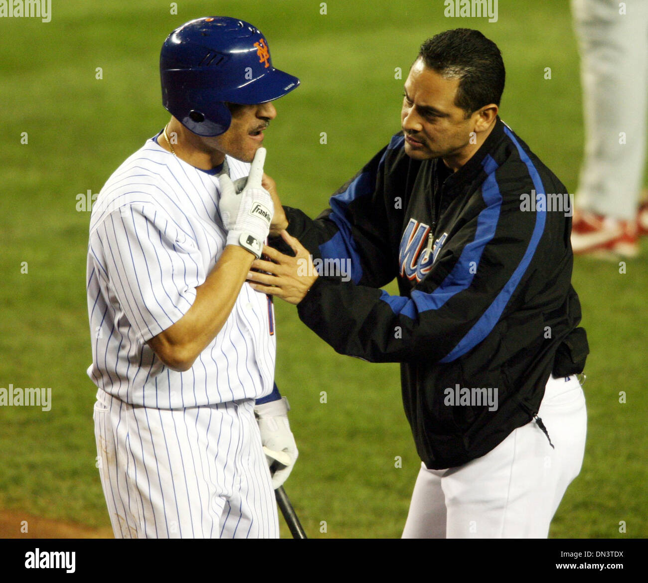 Oct 19, 2006; New York, NY, USA; MLB: New York Mets second baseman JOSE VALENTIN is check out by a trainer after Stock Photo