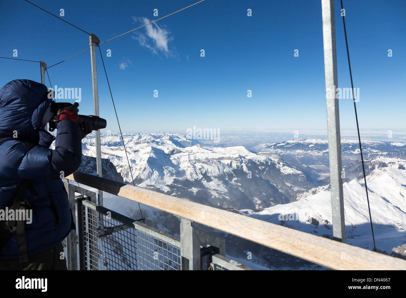 photographing from the deck of the Sphinx Observatory, Jungfraujoch, Switzerland - Stock Image