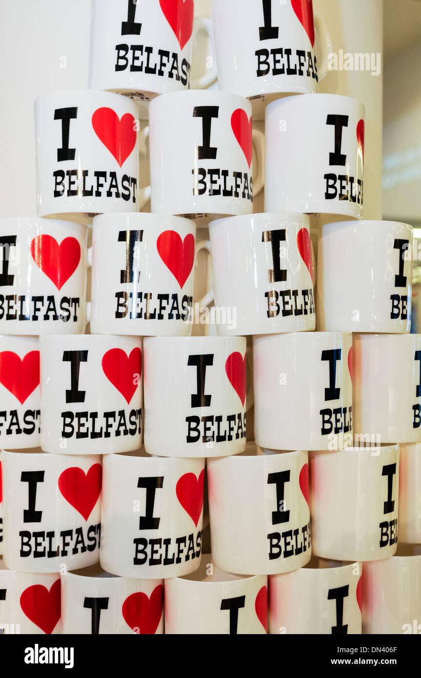 'I love Belfast' souvenir mugs on sale in Visit Belfast tourist information centre - Stock Image