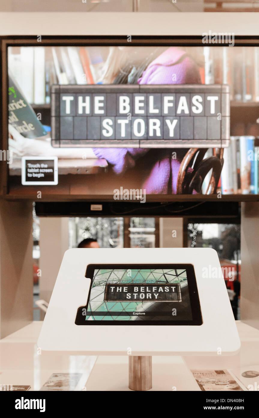 An interactive display describing the 'Belfast Story' in Visit Belfast tourist information centre - Stock Image