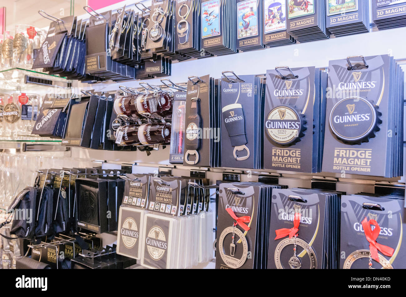 Guinness branded souvenirs on sale in an Irish tourist information centre - Stock Image