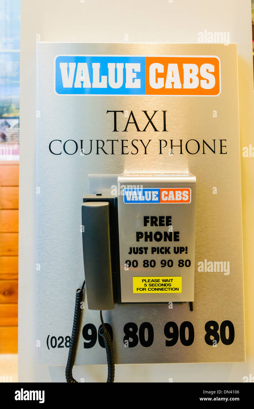 A courtesy phone for Value Cabs taxi company in Belfast in a local hotel Stock Photo