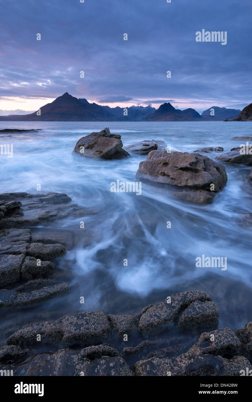 The Black Cuillin mountains from the rocky shores of Elgol, Isle of Skye, Scotland. Winter (December) 2013. - Stock Image