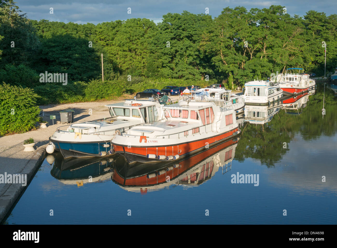 Canal cruisers moored in the Canal du Centre near Chagny - Stock Image