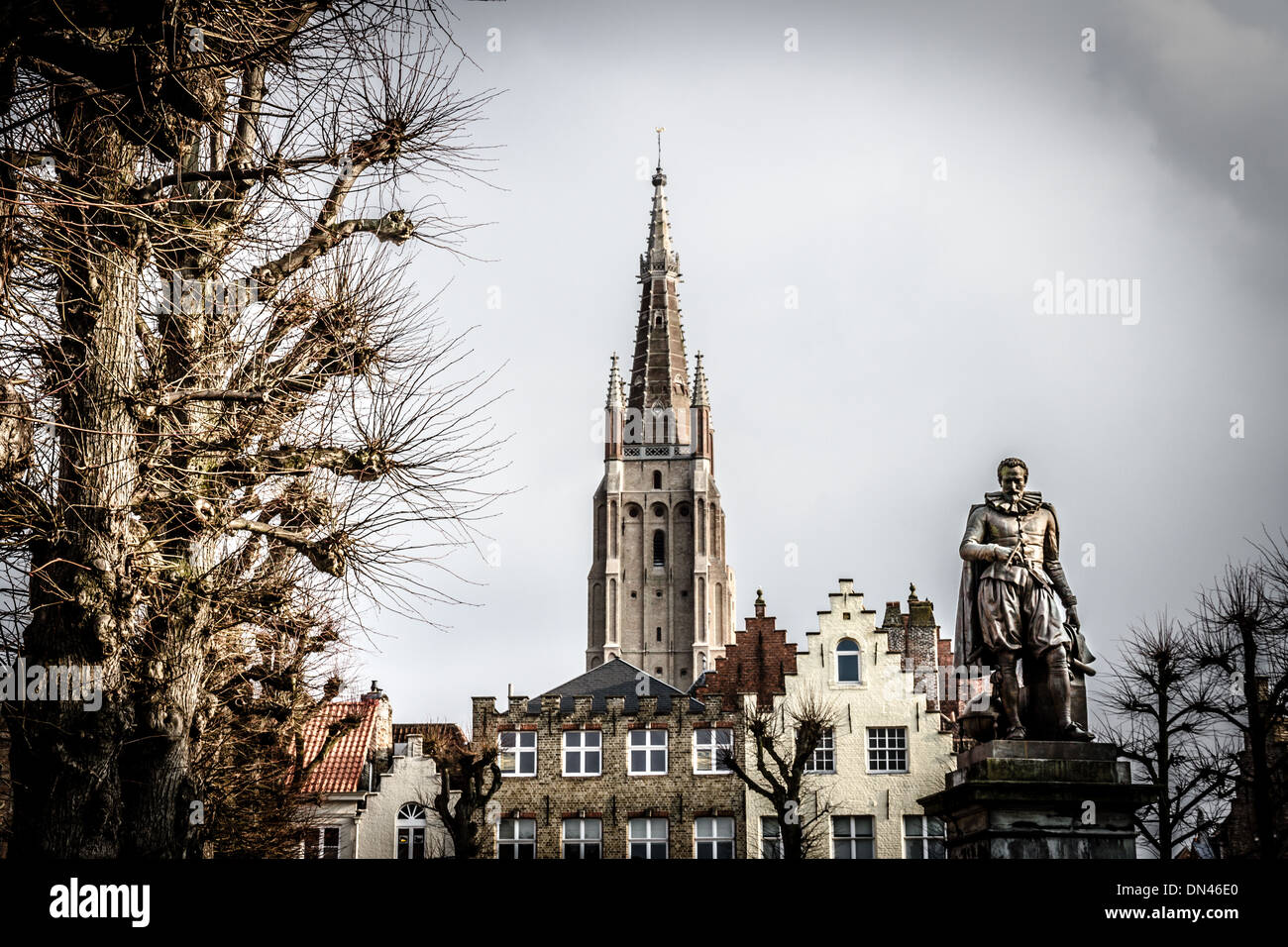 Statue of Flemish mathematician Simon Stevin in front of the Church of our Lady in medieval Bruges, Belgium - Stock Image