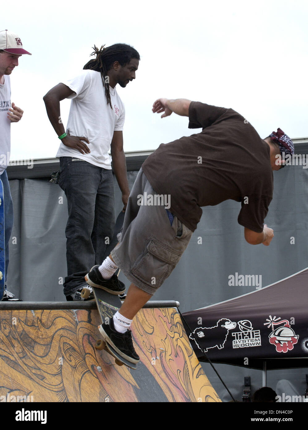 Jun 27, 2006; Raleigh, NC, USA; A person rides a skateboard on a half pipe ramp at the 2006 Vans Warped Tour makes a stop at Alltel Pavilion located in Raleigh.  Mandatory Credit: Photo by Jason Moore/ZUMA Press. (©) Copyright 2006 by Jason Moore - Stock Image