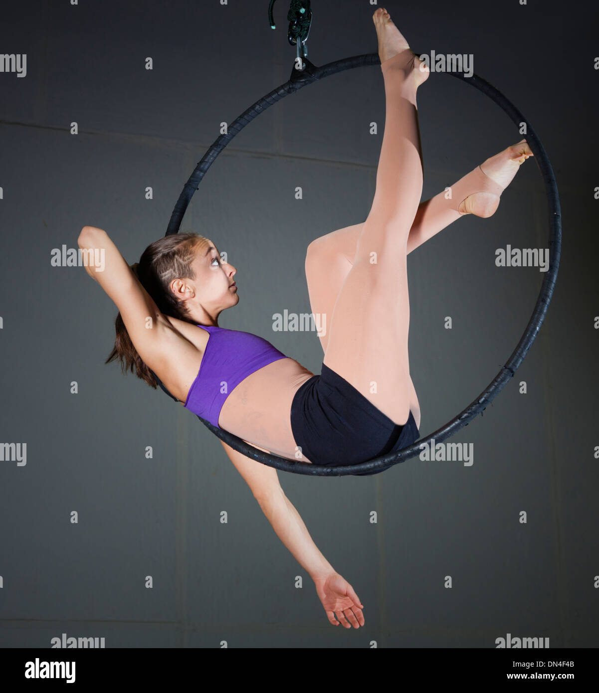 Gymnast performing aerial exercises - Stock Image