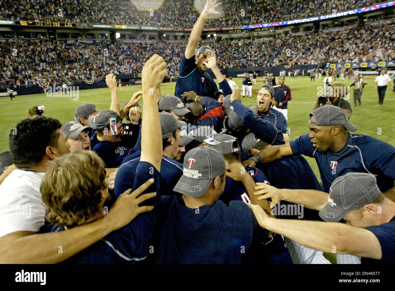 Oct 01, 2006; Minneapolis, MN, USA; The Minesota Twins celebrate winning their division in centerfield after Detroit's loss to Kansas City during the conclusion of their game against the Chicago White Sox at the Metordome in Minneapolis, Minnesota, Sunday, October 1, 2006. The Twins defeated the White Sox 5-1. Mandatory Credit: Photo by Marlin Levison/Minneapolis Star T/ZUMA Press. Stock Photo