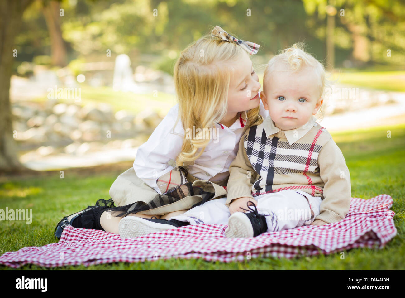 beautiful baby boy and girl kiss