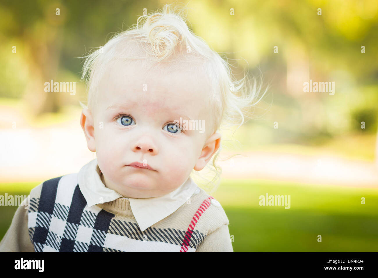 a49c6a6ff Adorable Little Blonde Baby Boy Outdoors at the Park. - Stock Image