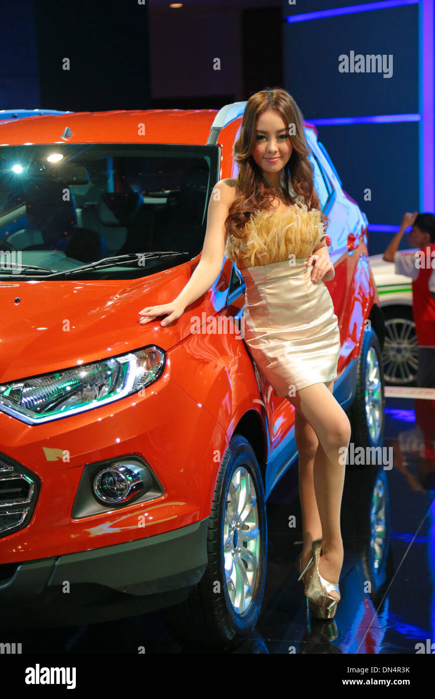 Ford showgirl posing for visitors at KL International Motorshow (KLIMS) 2013. - Stock Image
