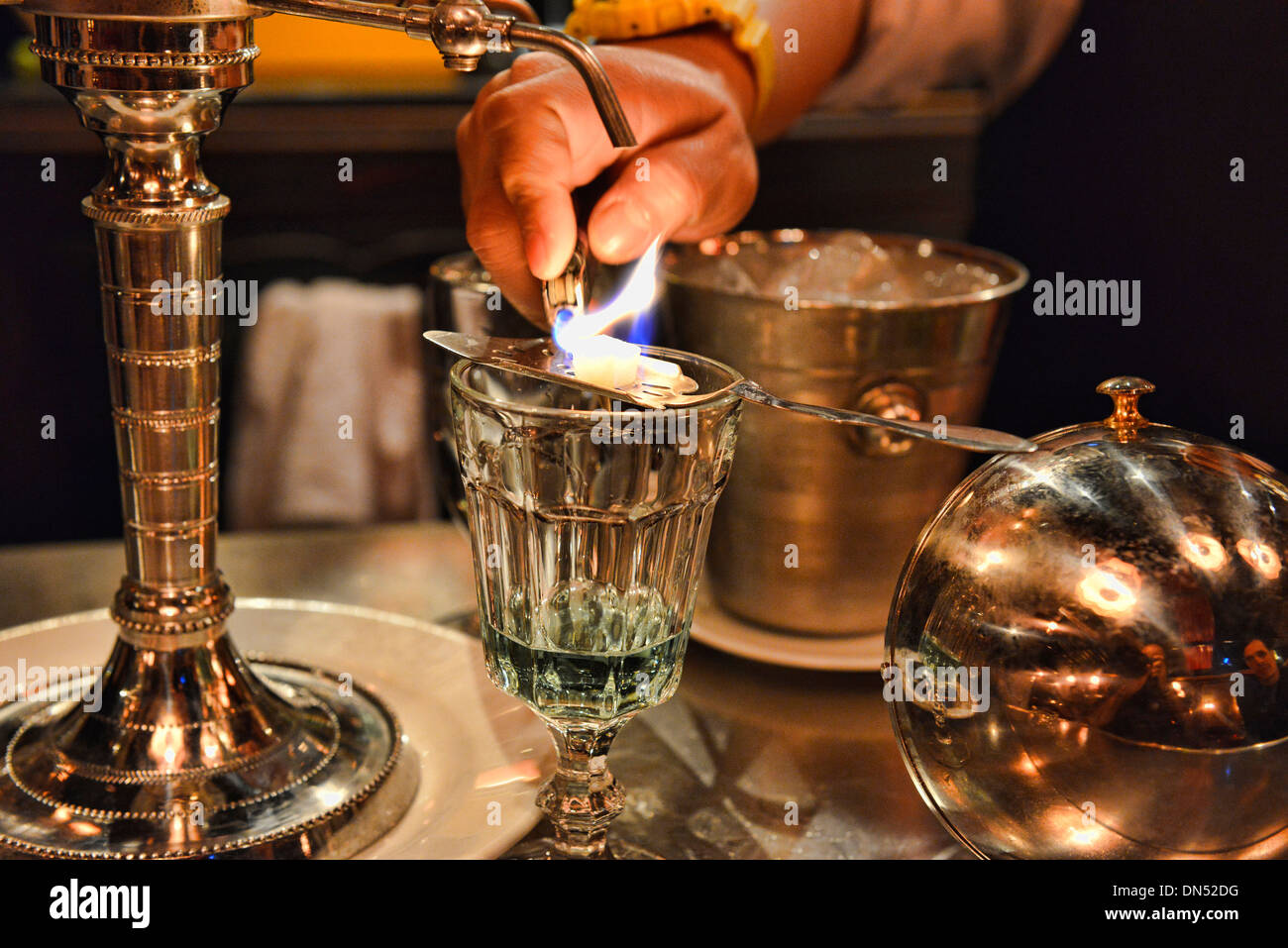 pouring absinthe the traditional way, Bangkok, Thailand - Stock Image