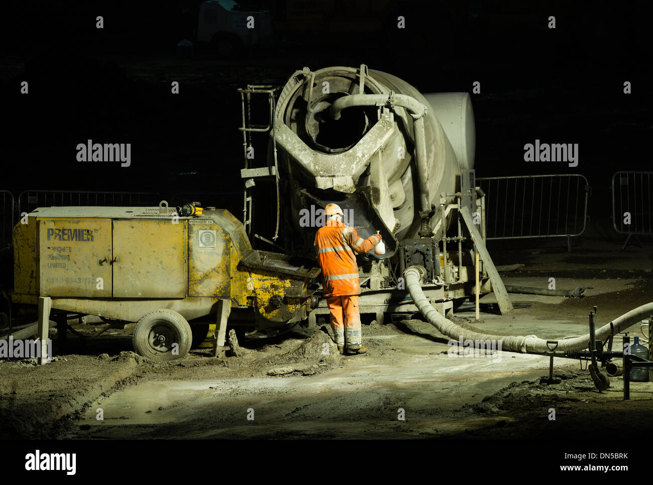 Cement Mixer on building site at night. UK - Stock Image
