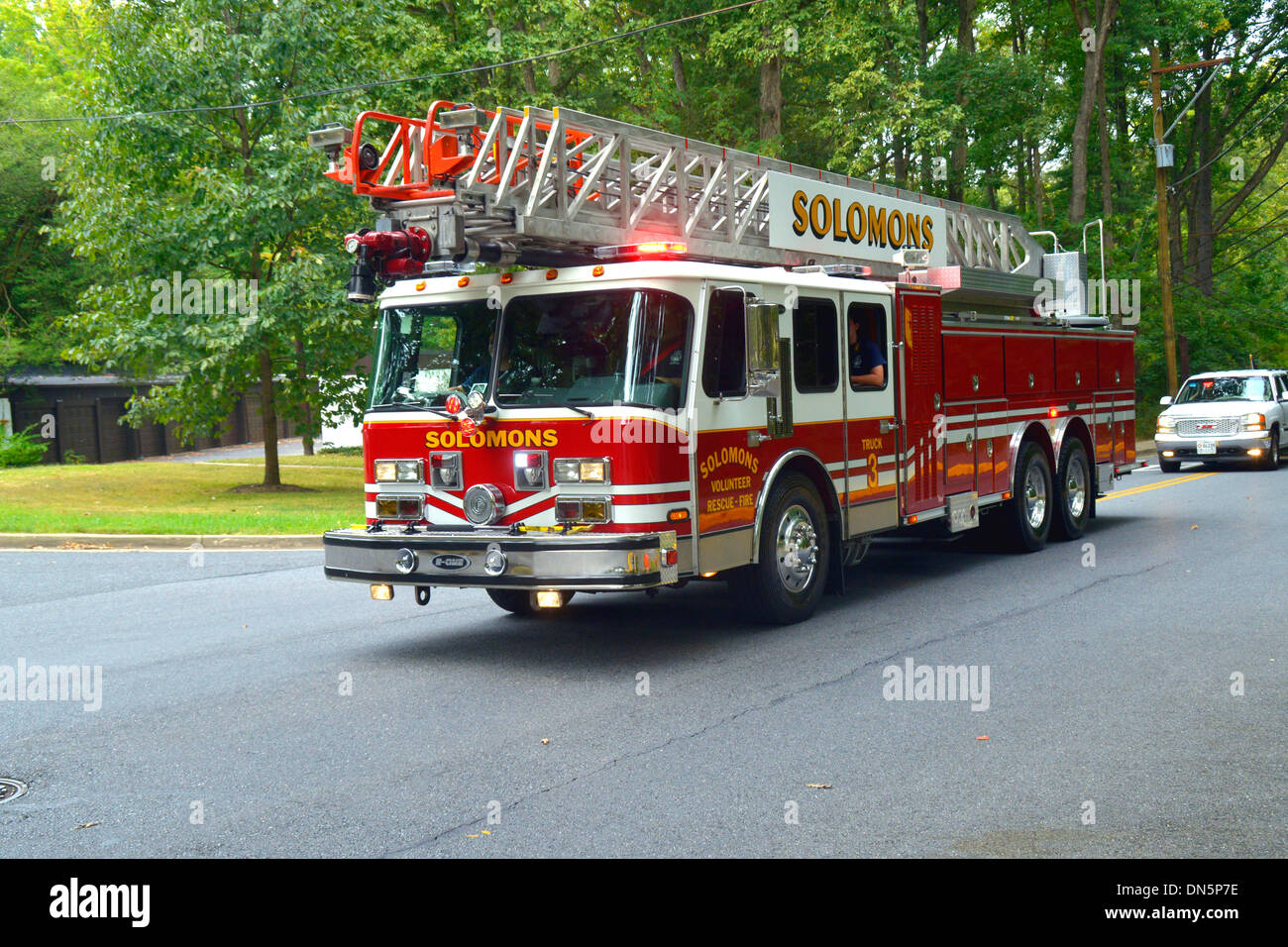 A Ladder truck fire truck from Solomon's Volunteer Fire Department responding on a call - Stock Image