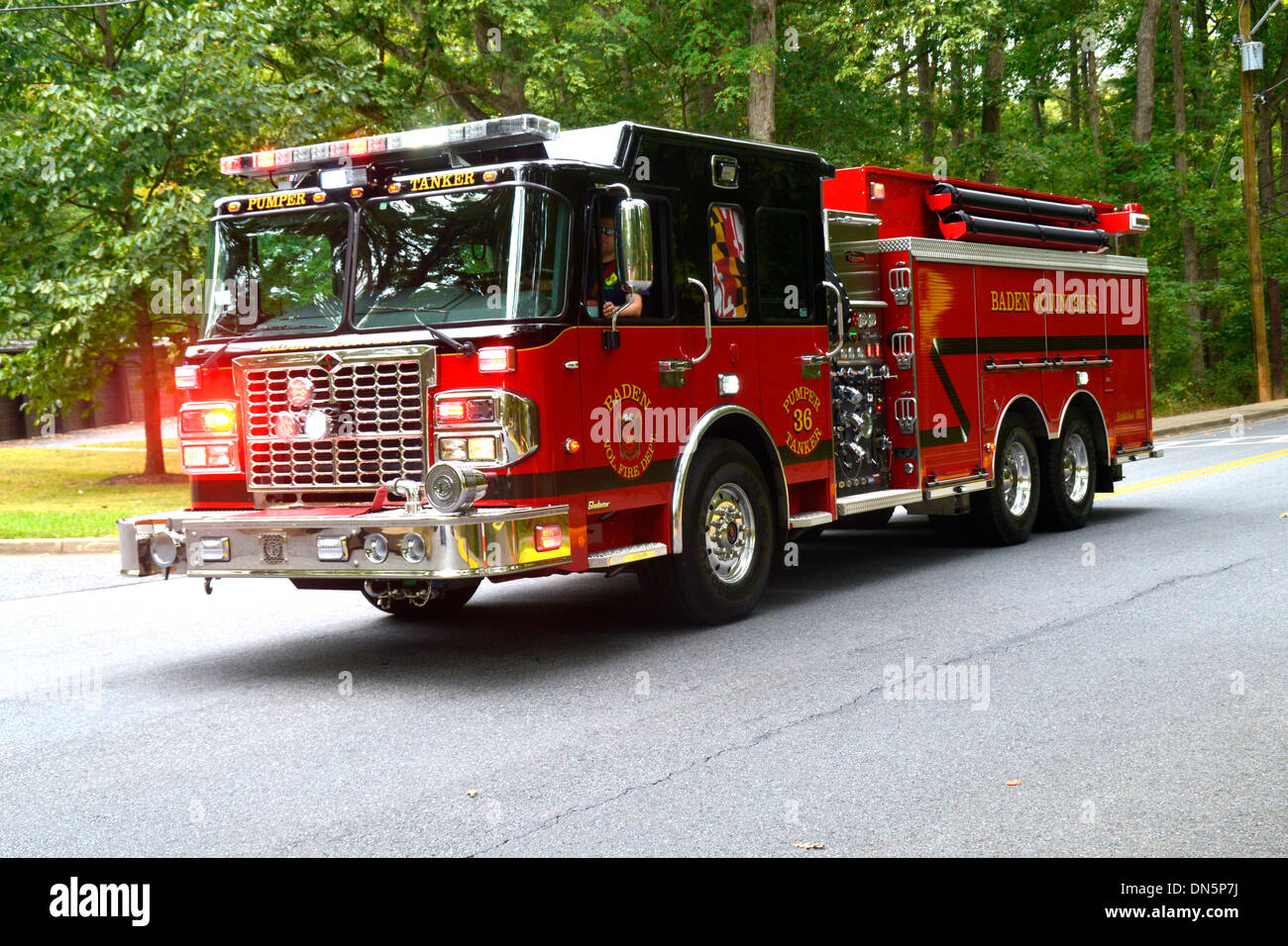A combination pumper tanker from Baden Volunteer Fire Department responding on a emergency call - Stock Image
