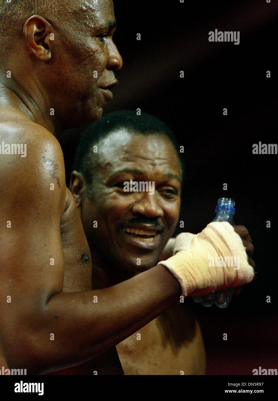 Nov. 30, 2006 - Memphis, Tennessee, U.S. - JOE FRAZIER, 62, right, and Memphis Mayor WILLIE HERENTON, 66, left, hug after their benefit boxing match at the Peabody Hotel. (Credit Image: © Mark Weber/The Commercial Appeal/ZUMApress.com) - Stock Image