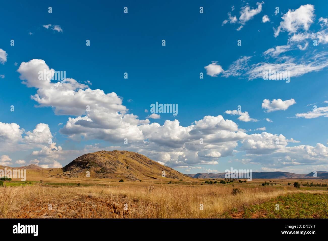 Vast arid landscape, blue sky with clouds, Isalo National Park near Ranohira, Madagascar Stock Photo