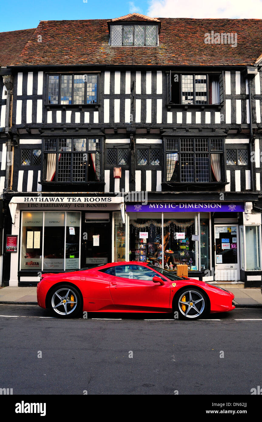 Ferrari car parked in front of a half-timbered house, Stratford-upon-Avon, Warwickshire, England, United Kingdom - Stock Image
