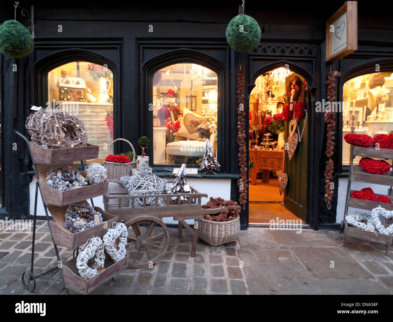 Christmas decorations and wreaths for sale outside a gift shop in ...
