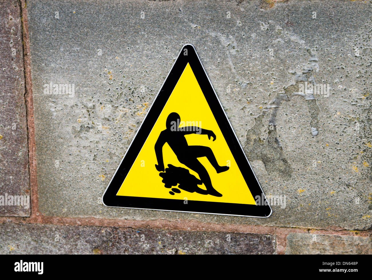 Warning sign for slippery surface, Cardiff Bay, Wales. - Stock Image
