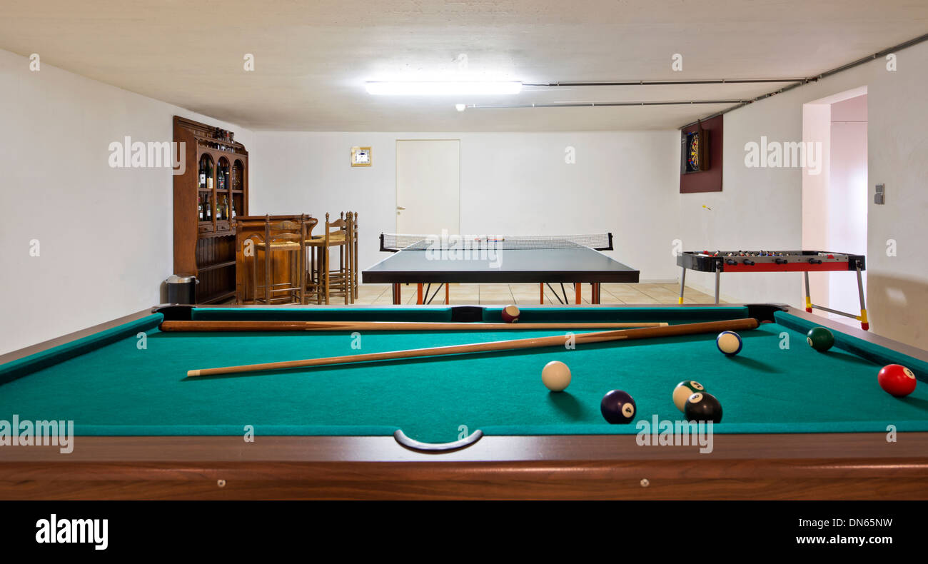 Pool Table And Ping Pong Table In Basement