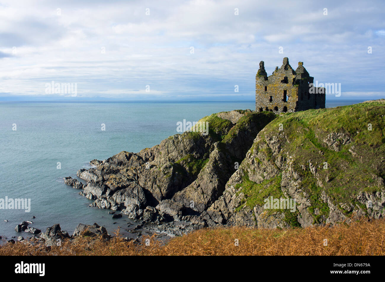 Ruined Castle looking out to sea on the cliffs on the west coast of Scotland. - Stock Image