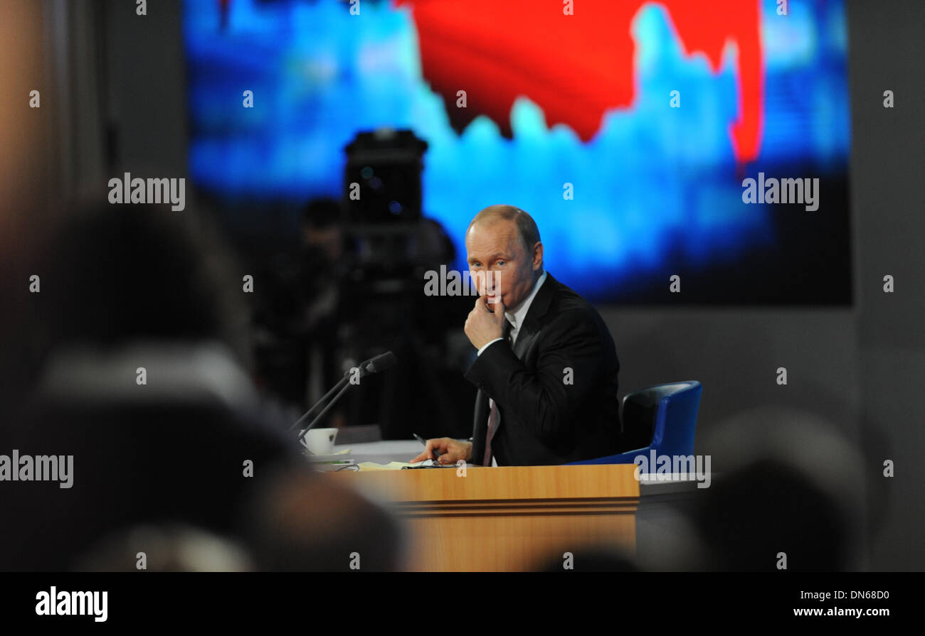 Moscow, Russia. 19th Dec, 2013. Russian President Vladimir Putin attends his annual news conference in Moscow, Russia, Dec. 19, 2013. Russia had not deployed its Iskander tactical nuclear missiles in Kaliningrad, President Vladimir Putin said Thursday. Credit:  Liu Hongxia/Xinhua/Alamy Live News - Stock Image