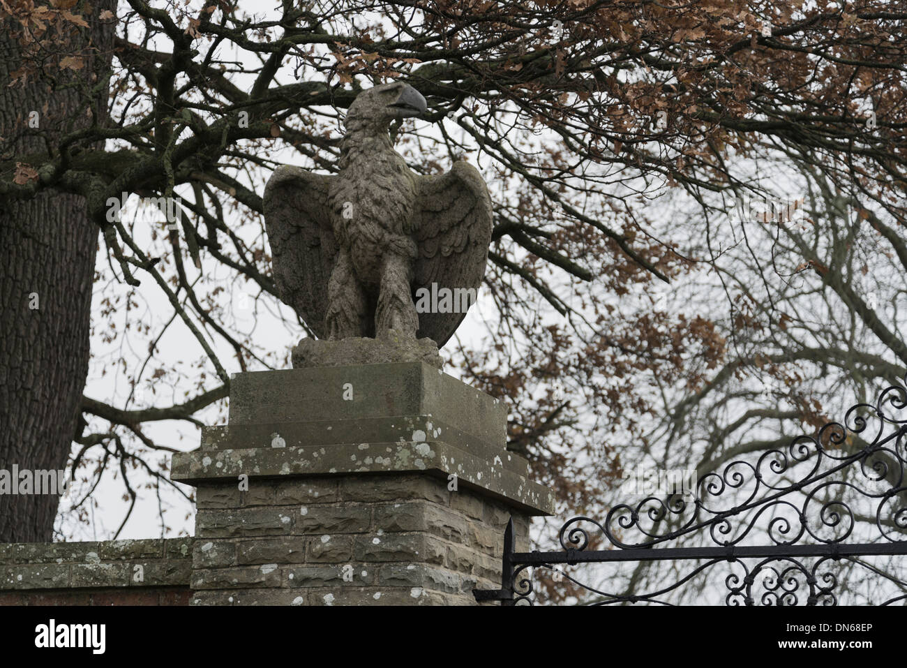 Eagle statues atop of entrance gate posts to country houses Stock Photo
