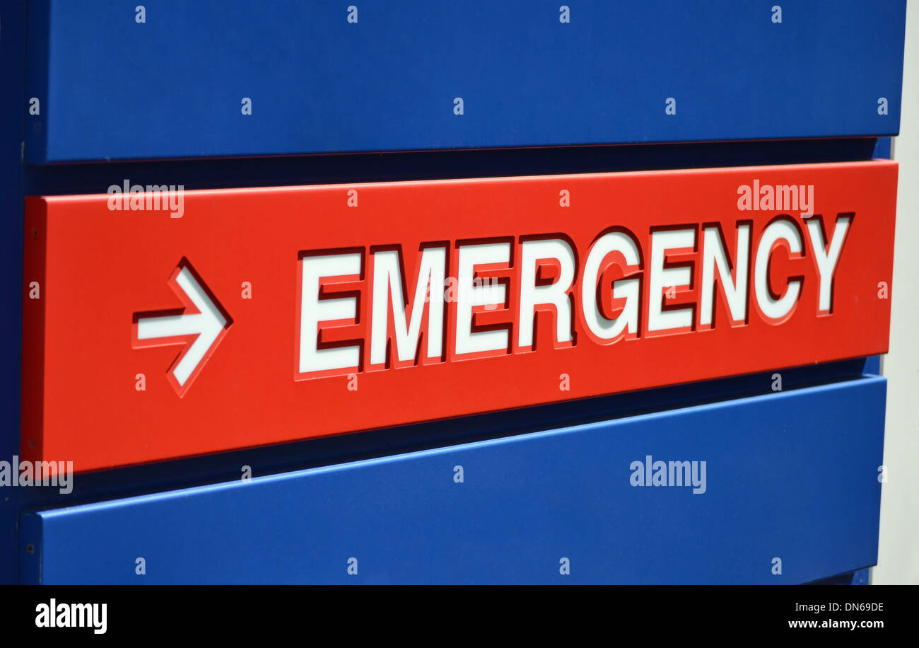 A blue and red Emergency sign outside a hospital - Stock Image