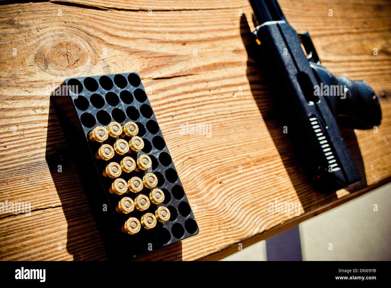 Bullets and the gun. - Stock Image