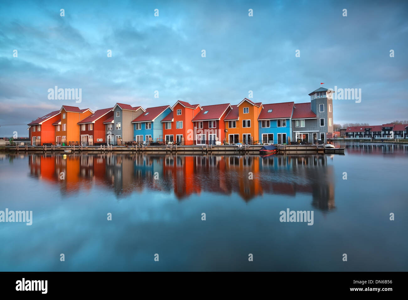 colorful buildings on water at sunrise, Groningen, Netherlands - Stock Image
