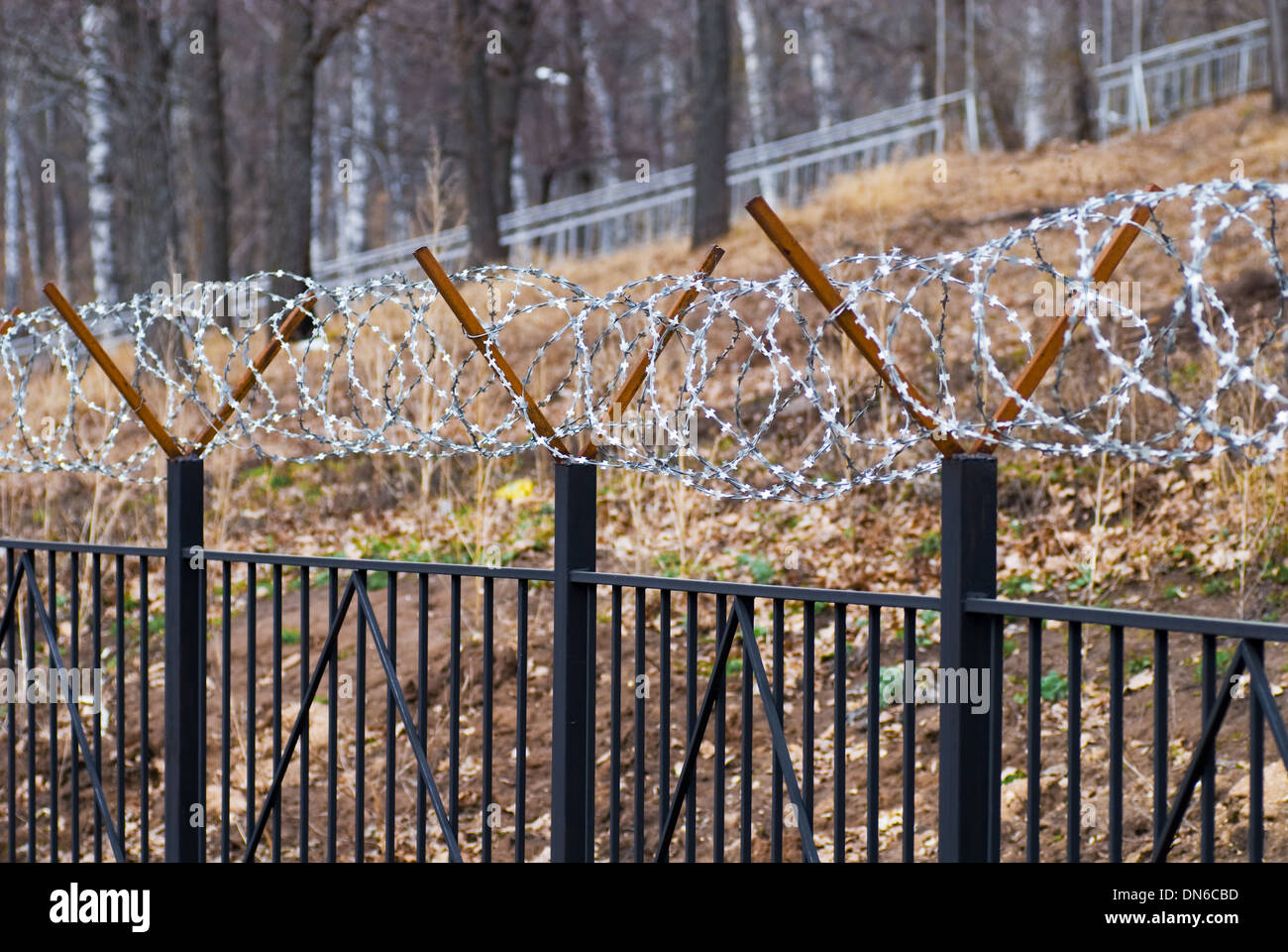 A barbed wire fence of closeup - Stock Image