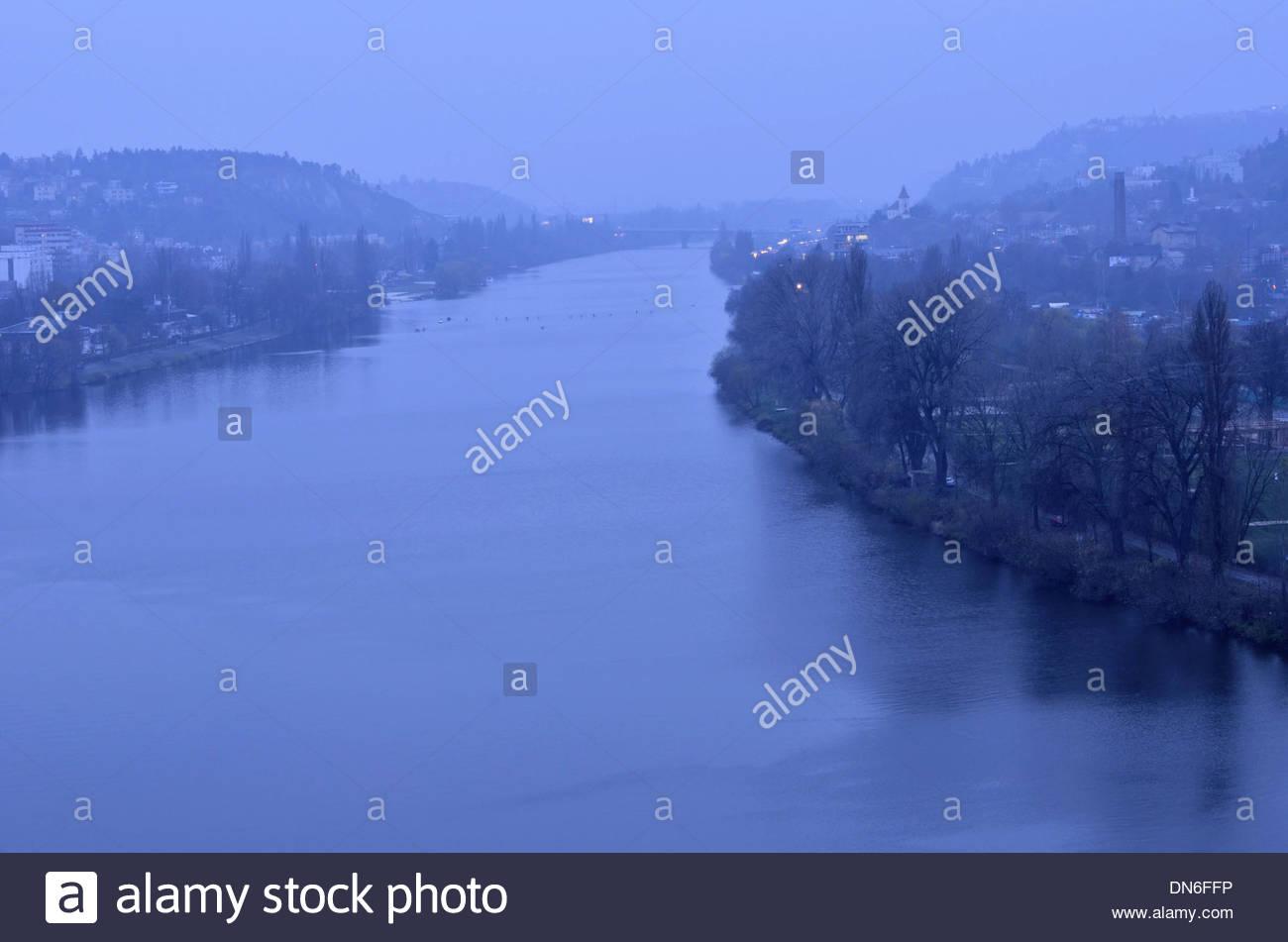 River Vltava (Moldau) at dusk cloudy rainy winter in Prague Czech Republic. - Stock Image