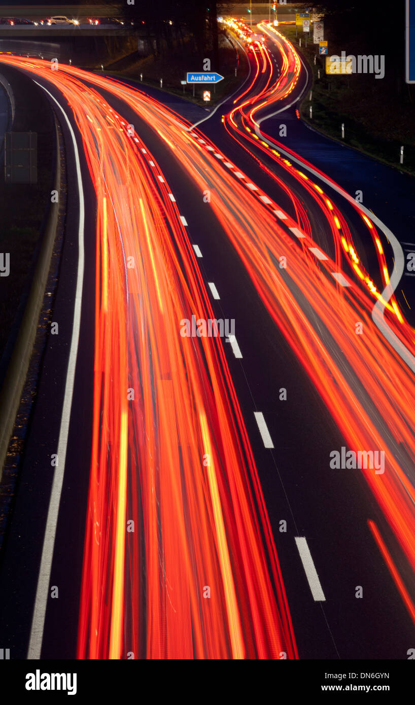 Traffic trails on Germany's A40 Autobahn, motorway, at dusk, Mülheim an der Ruhr, Germany - Stock Image