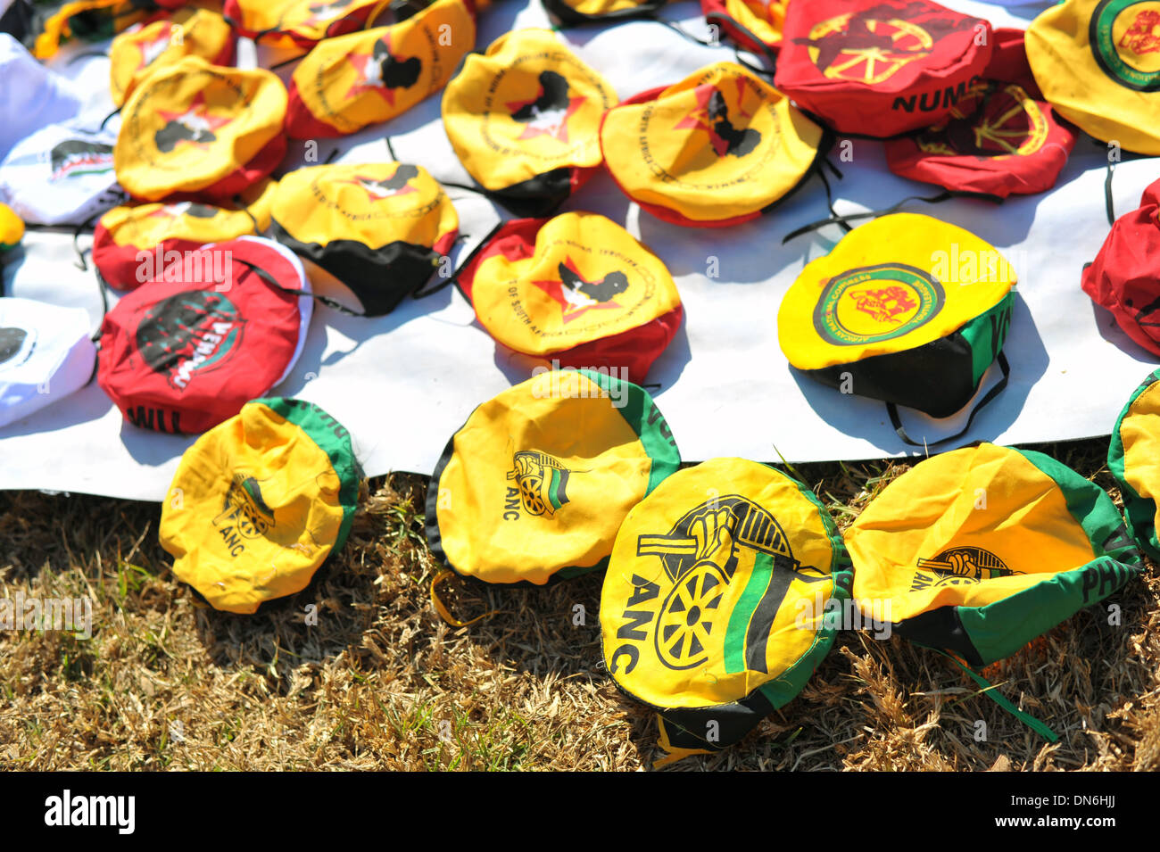 Lots of ANC hats on the ground at a protest in South Africa. - Stock Image