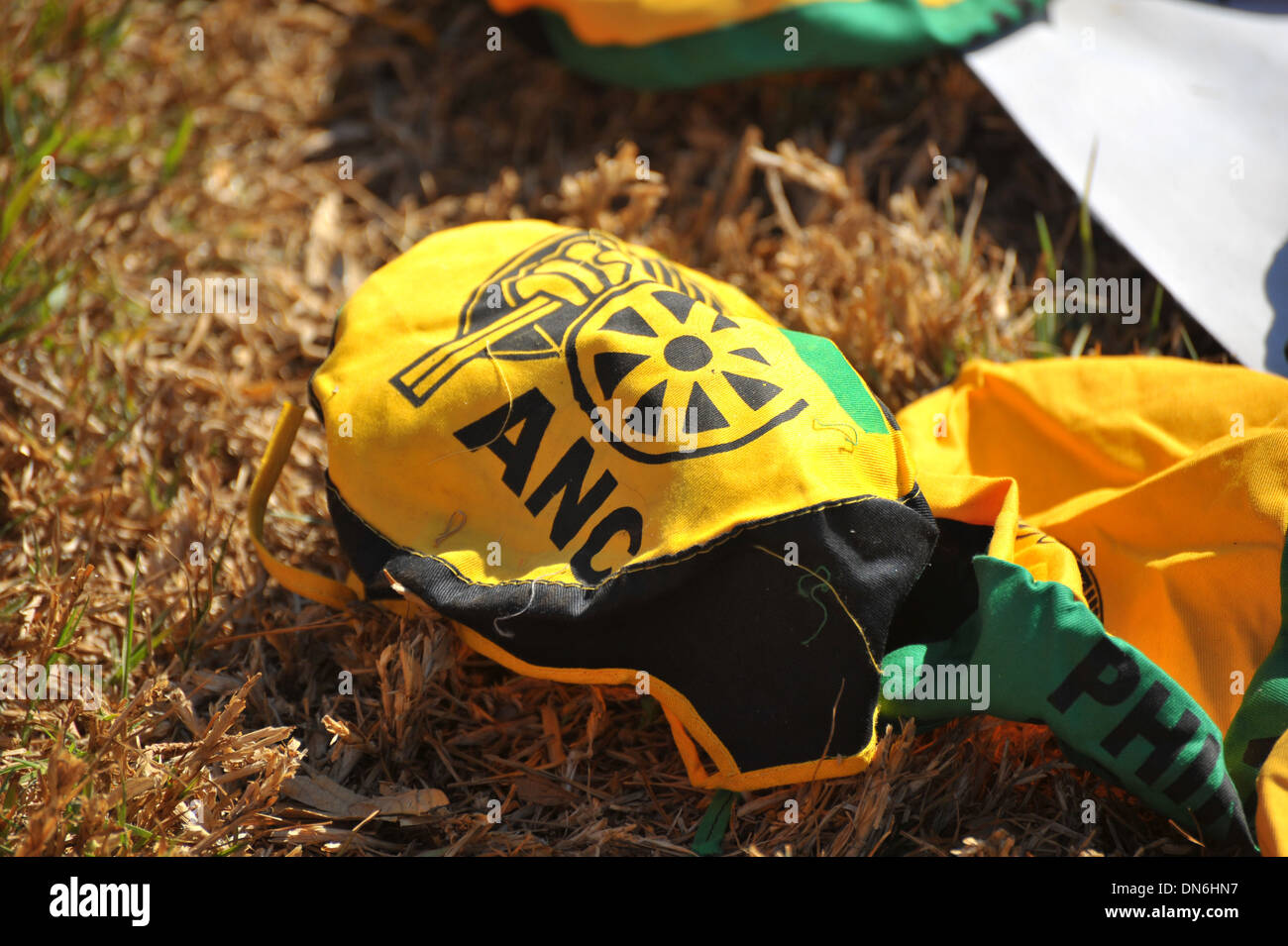 An ANC political cap on the ground in South Africa. - Stock Image