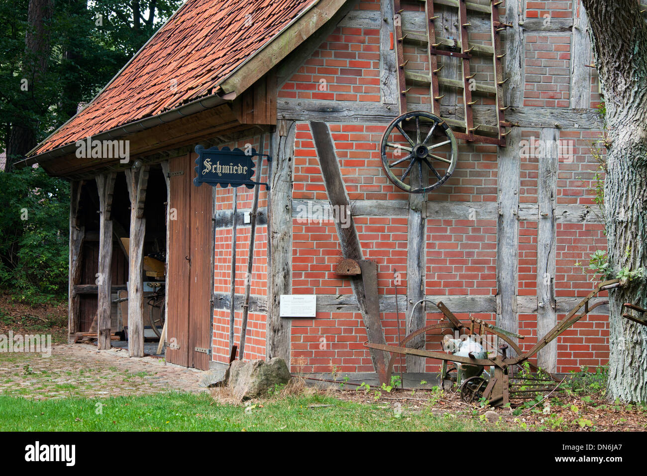 Old forge at the Heimathaus De Theeshof, open air museum at Schneverdingen, Lüneburg Heath / Lunenburg Heathland, Germany - Stock Image