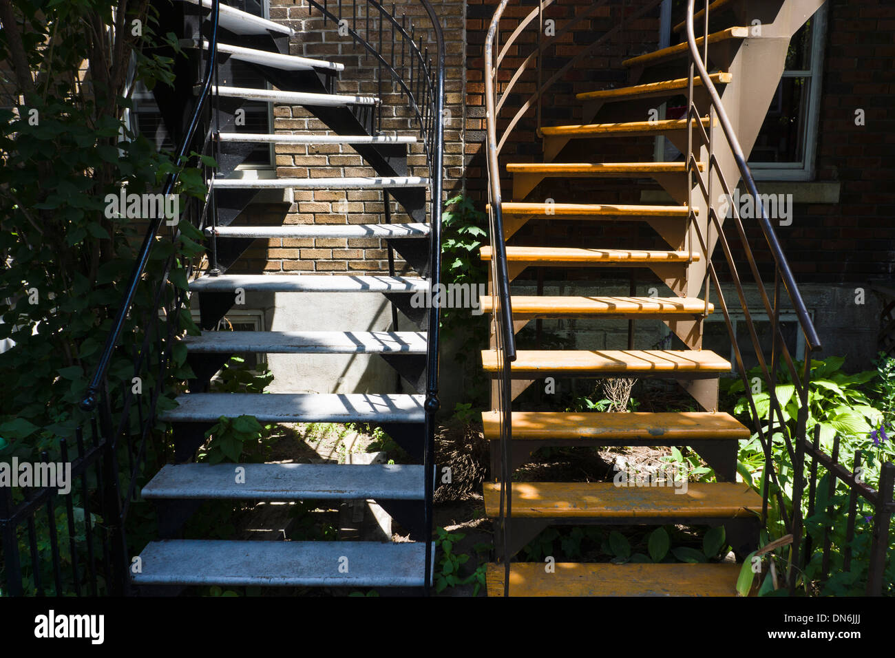 Typical iron exterior staircases in Montreal, Quebec, Canada. - Stock Image