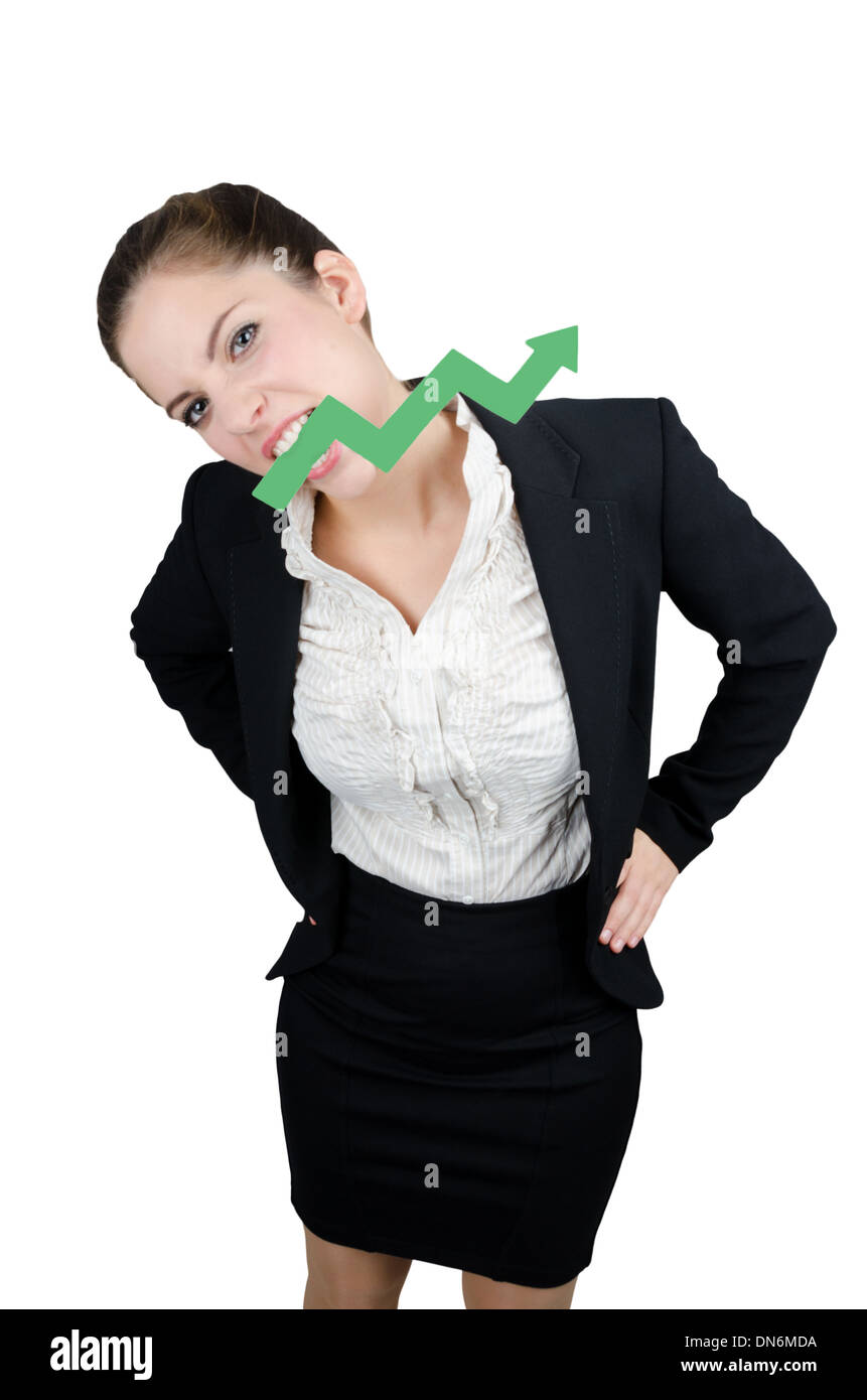 Business woman biting a green arrow pointing up - Stock Image