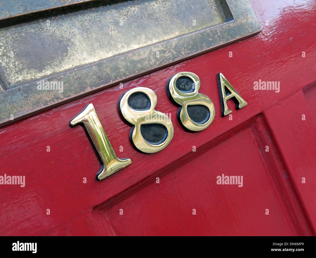 Red door number 118a Stock Photo