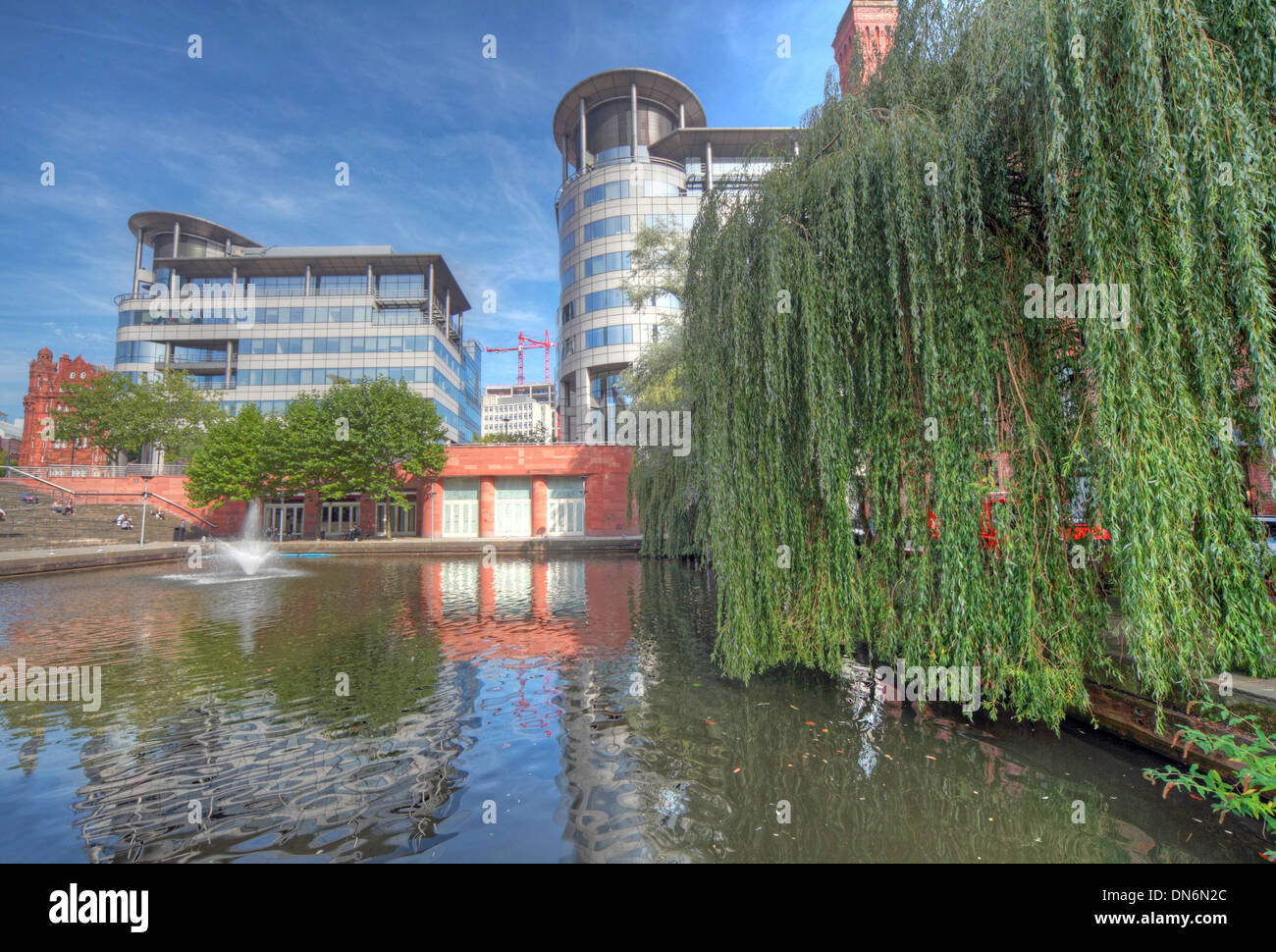 Wide angle shot of Bridgewater Hall & 101 Barbirolli Square Manchester, England UK with canal basin reflections - Stock Image