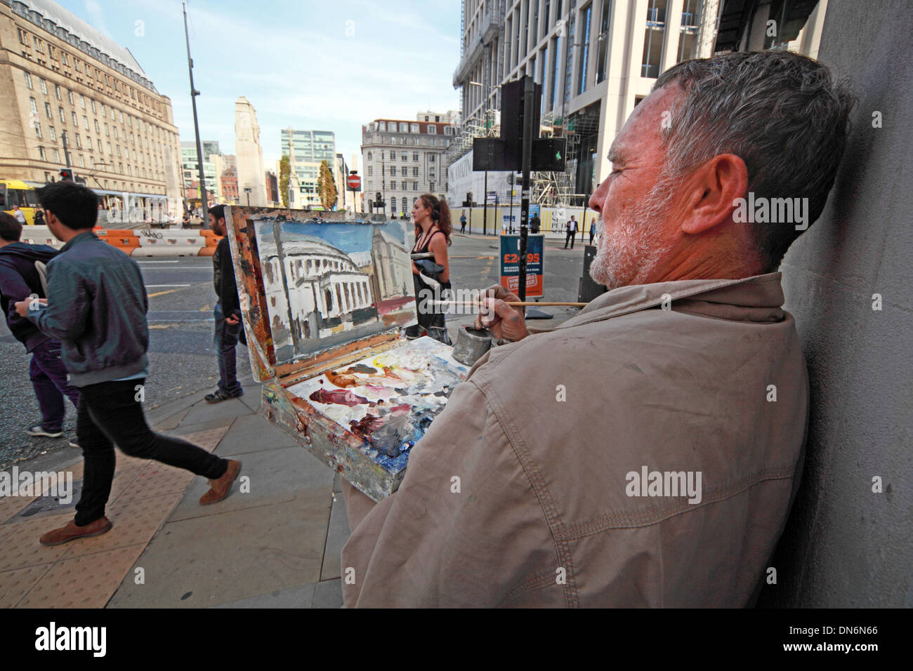 Street artist in Manchester City Centre England UK - Stock Image