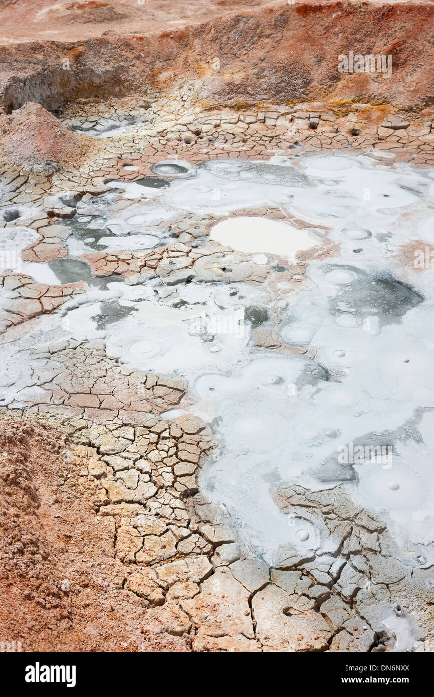 Cracked mud and bubbling minerals at Sol de Manana Stock Photo